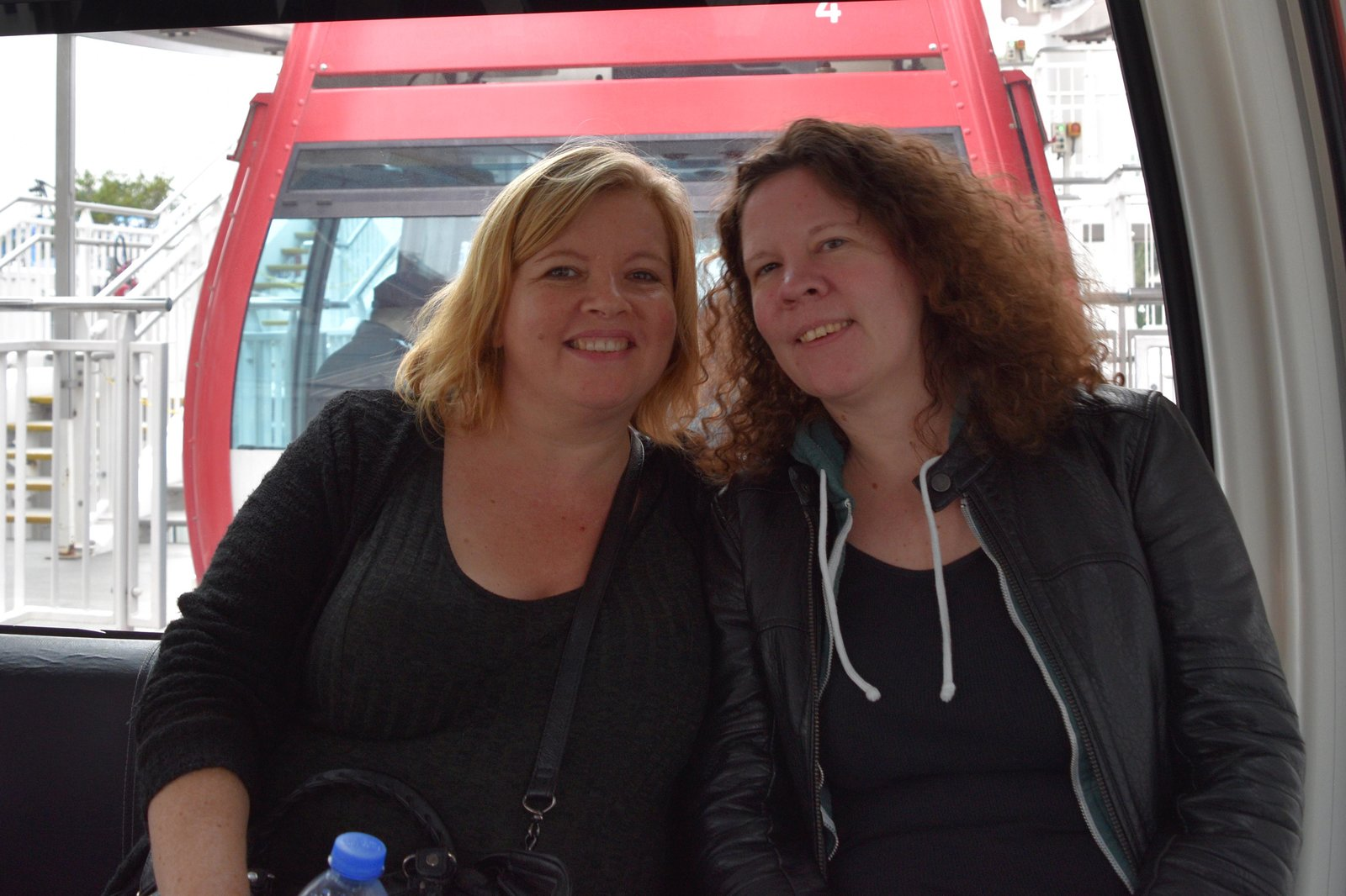 Tracy and Stef Riding a Ferris Wheel