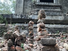 Stacked stones outside an old temple in Sangklaburi